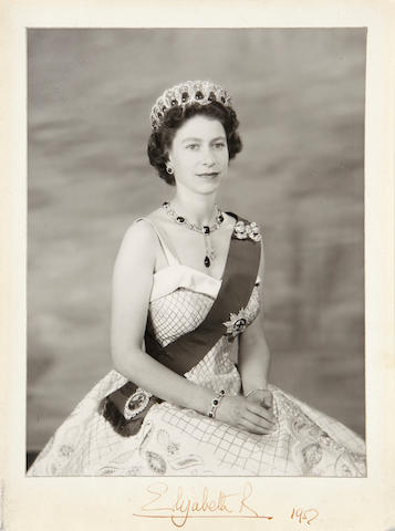 "BRITISH ROYAL FAMILY.  1. Photograph Signed (""Elizabeth R"") and dated 1952, seated portrait of Queen Elizabeth II wearing the crown jewels, in morocco picture frame with gilt royal monogram."