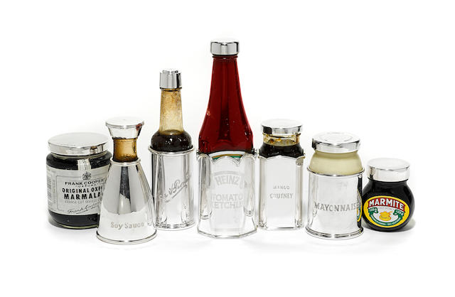 A collection of seven Theo Fennell sterling silver tabletop condiment lids and sleeves,  London,  contemporary