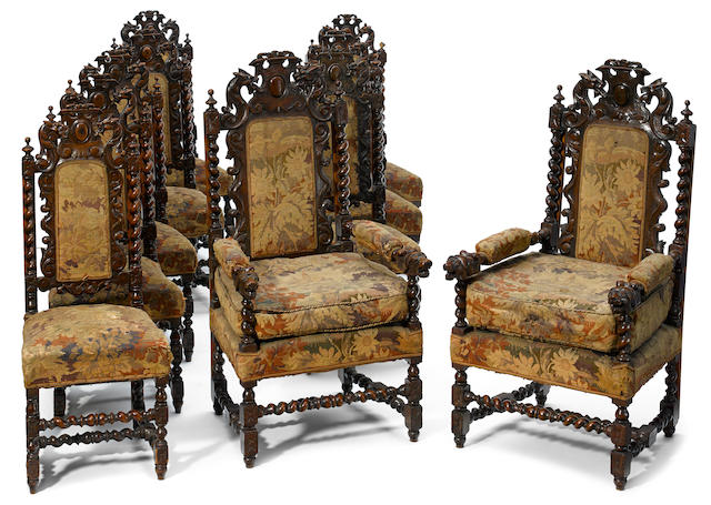 A set of ten Continental Baroque style carved oak dining chairs late 19th century