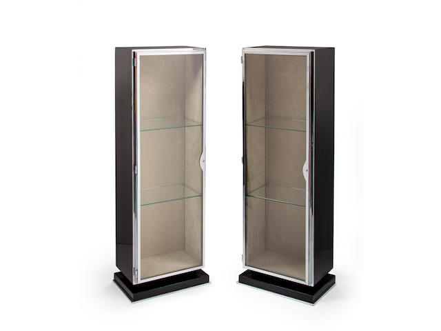 A pair of Emile-Jacques Ruhlmann black lacquered wood and metal vitrines circa 1925