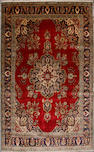 A Tabriz carpet  size approximately 9ft. 9in. x 12ft. 5in.