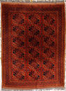 An Afghan rug  size approximately 6ft. 11in. x 9ft. 9in.