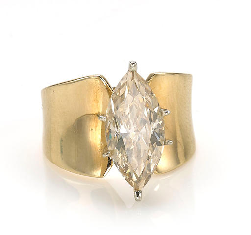 A colored diamond solitaire ring