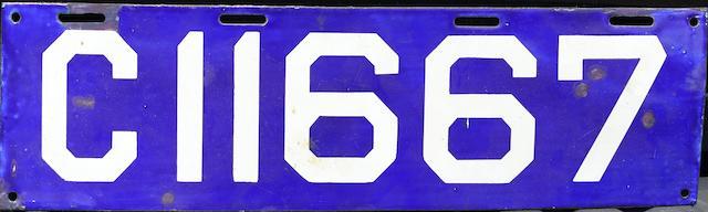 A porcelain enameled vintage licence plate,