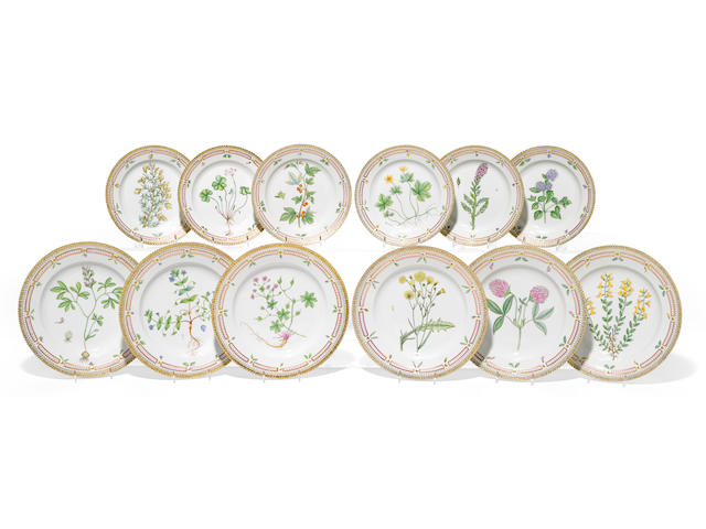 A suite of twelve Royal Copenhagen Flora Danica porcelain salad and dinner plates