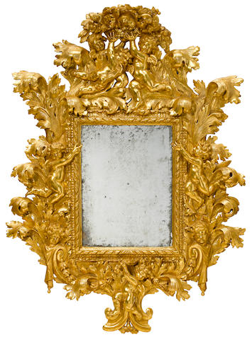 An imposing Italian Baroque carved giltwood mirror first half 18th century