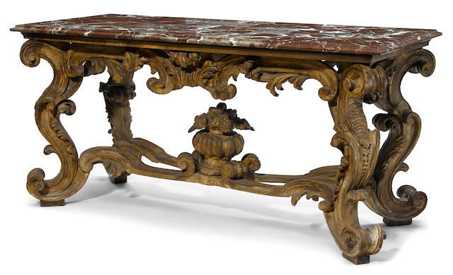 A Continental Baroque style parcel gilt center table