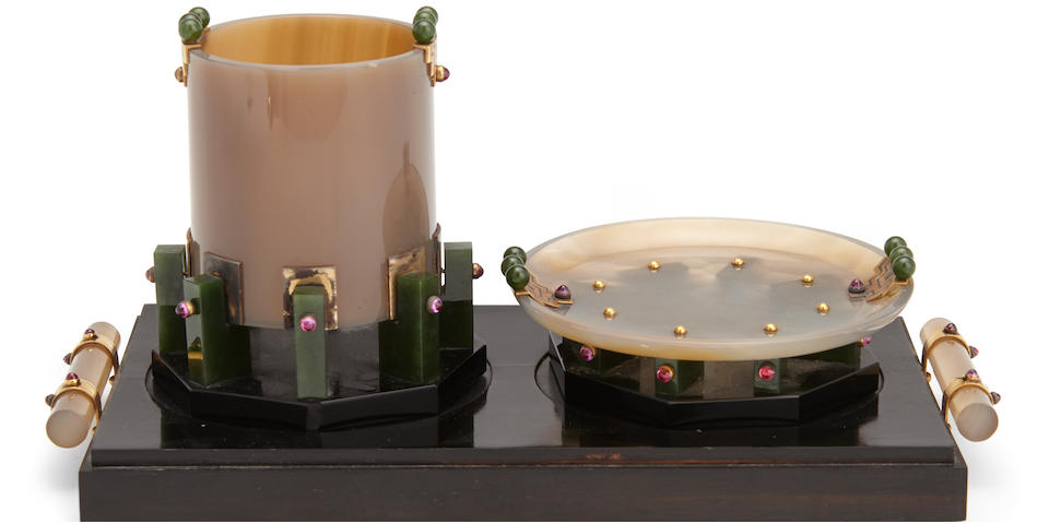 A French  enameled 18K yellow gold, silver-gilt and ruby mounted agate, nephrite and onyx Art Deco three-piece smoking set by Verger Frères, Paris; retailed by Brock & Co.,  circa 1925