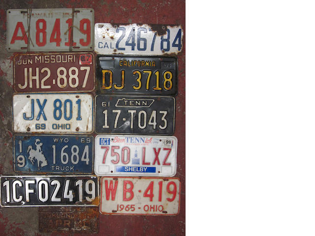 A grouping of assorted 30+ license plates,