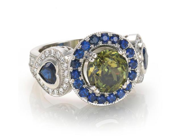 A color-change demantoid garnet, sapphire, diamond and chameleon diamond ring