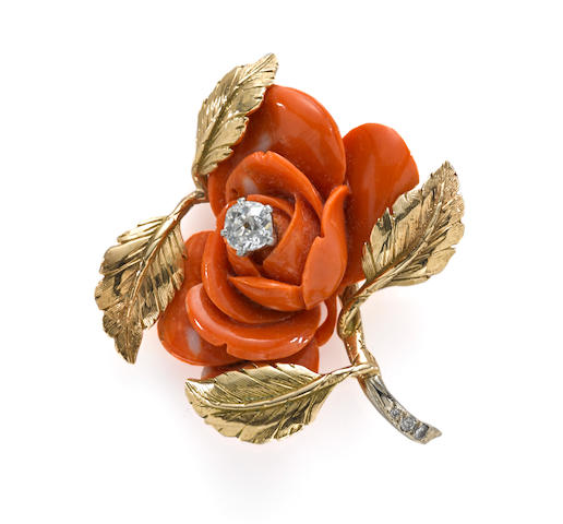 A carved coral and diamond rose brooch
