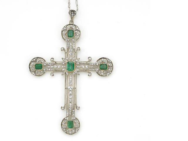 An emerald and diamond cruciform pendant with white metal chain
