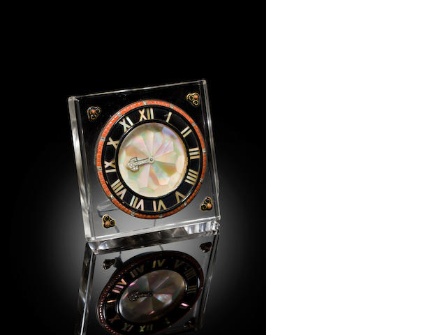 Cartier. A fine Art Deco rock crystal, mother of pearl, onyx, diamond and coral boudoir clock Signed European Watch and Clock Co., France, No. 1866 / 3358, with Cartier reference No. 970, 1920's