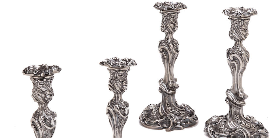 An assembled set of four William IV/Victorian  sterling silver  candlesticks three by John Watson, Sheffield, 1837; one by R & S Garrard & Co, London, 1884