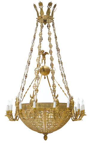 An Empire style gilt bronze sixteen light chandelier