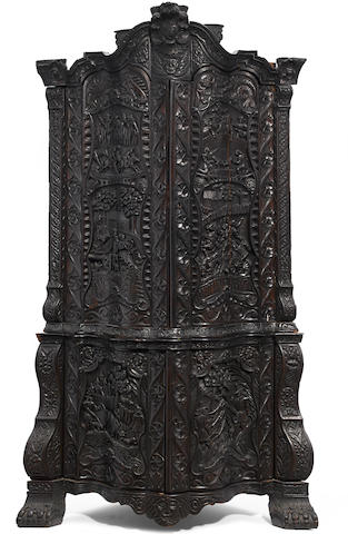 An Anglo-Dutch Baroque carved oak upright corner cupboard second half 18th century