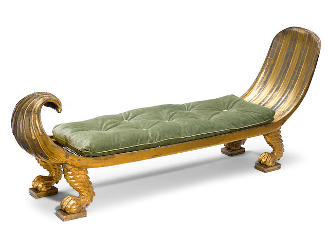 A fine and unusual Regency parcel paint decorated and carved giltwood daybed early 19th century