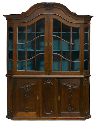 A German Rococo carved oak display cabinet second half 18th century