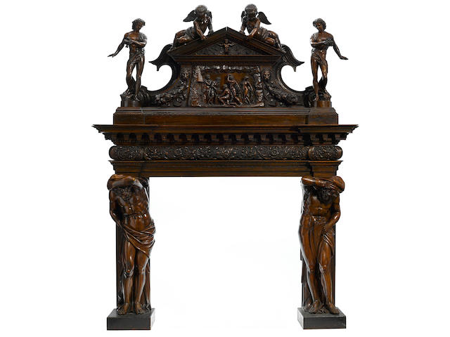 An exceptional Italian Renaissance Revival carved walnut fire surround late 19th century