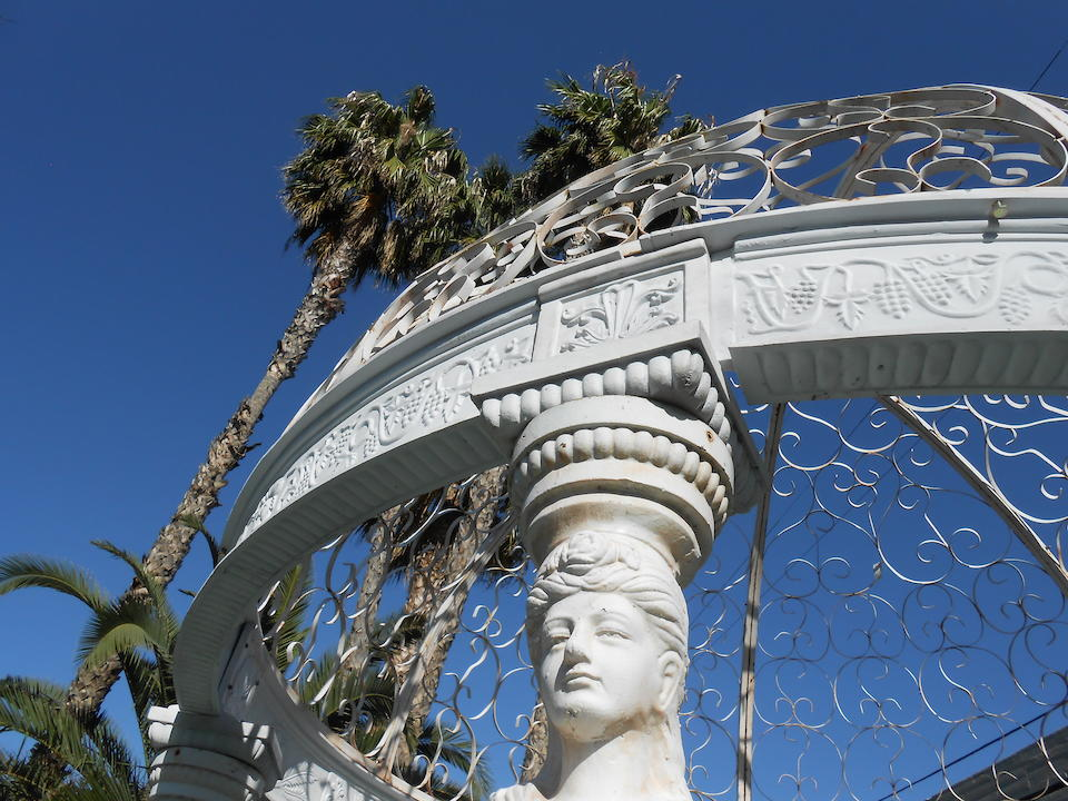 A Neoclassical style paint decorated cast iron gazebo