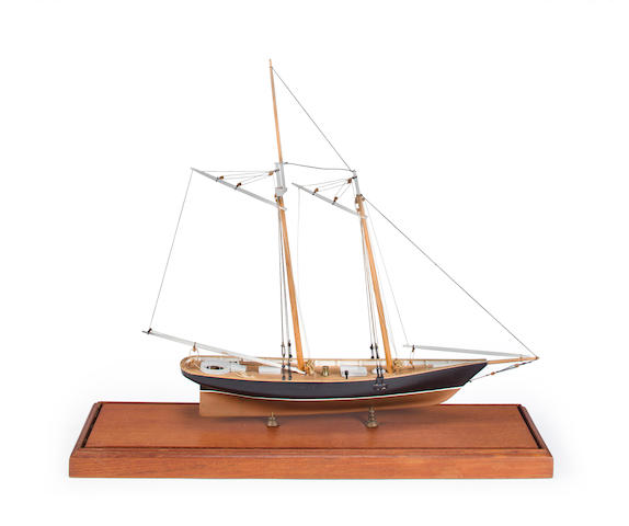 A small model of the schooner yacht America circa 1974 17-3/4 x 4-3/4 x 16-1/2 in. (45 x 12 x 41.9 cm.), model on base.