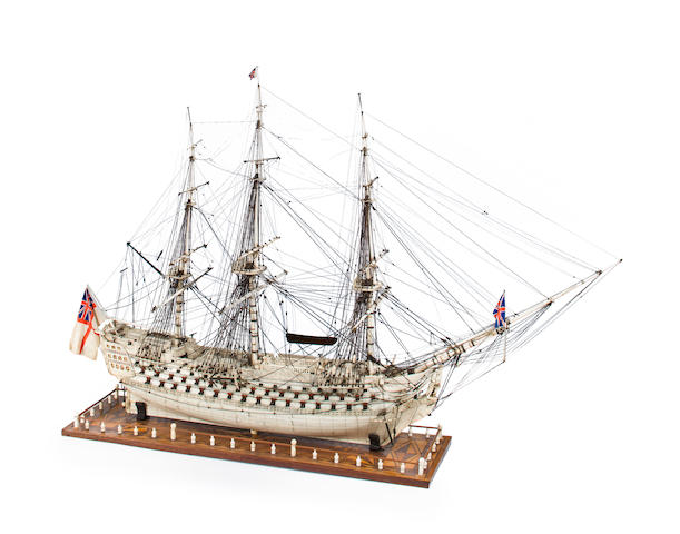 A Napoleonic prisoner-of-war bone model of a 120-gun ship-of-the-line H.M.S. Caledonia circa 1800 44 x 13 x 30-1/2 in. (111.7 x 33 x 77.4 cm.), model on stand.