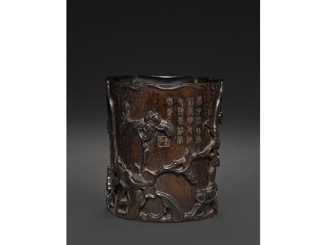 A carved zitan brush pot
