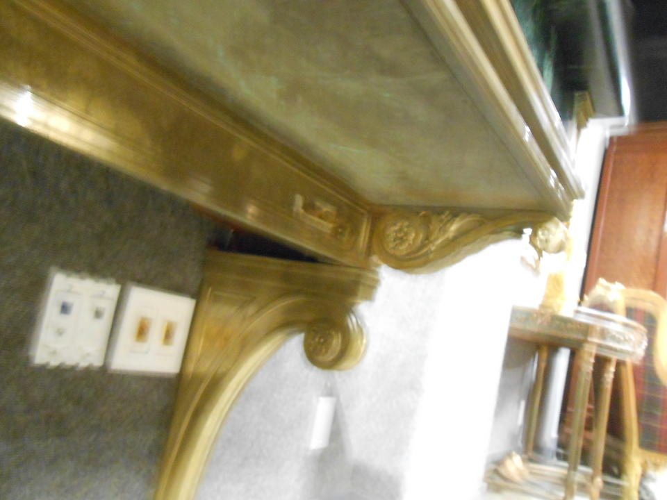 A pair of French gilt bronze bank console tables
