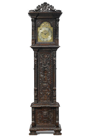 An imposing Renaissance Revival carved walnut quarter chiming tallcase clock late 19th century
