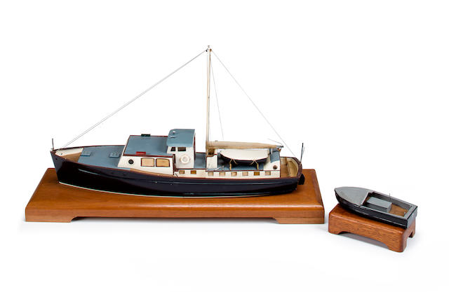 A waterline model of the motor yacht Exact circa 1975 17-1/4 x 5 x 10 in. (43.8 x 12.7 x 25.4 cm.), model on base, the larger. 2