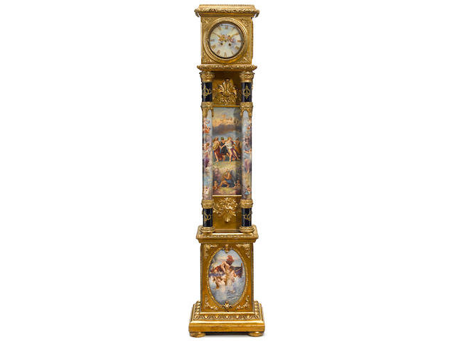 A fine Berlin (K.P.M.) and German porcelain and carved giltwood tallcase clock late 19th century