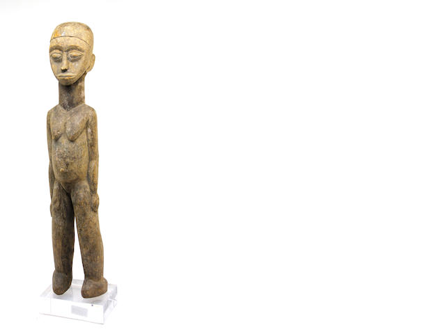 A Lobi Ancestral carved wood figure of a woman