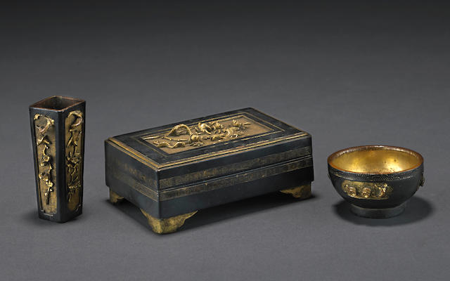 A group of three small gilt bronze containers 18th century