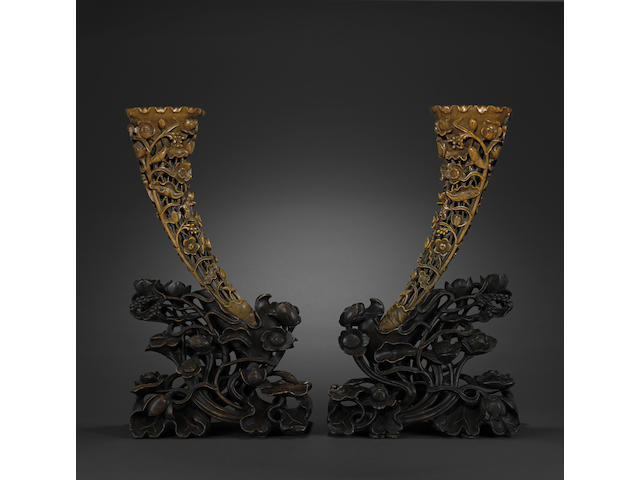 A pair of rhinoceros horn presentation carvings 19th century
