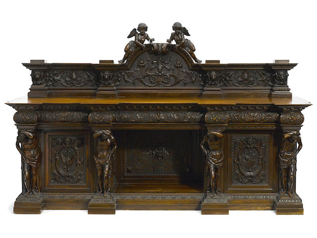 An exceptional Italian carved walnut sideboard late 19th century