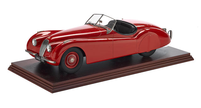 A 1:8 scale model of a Jaguar XK120,