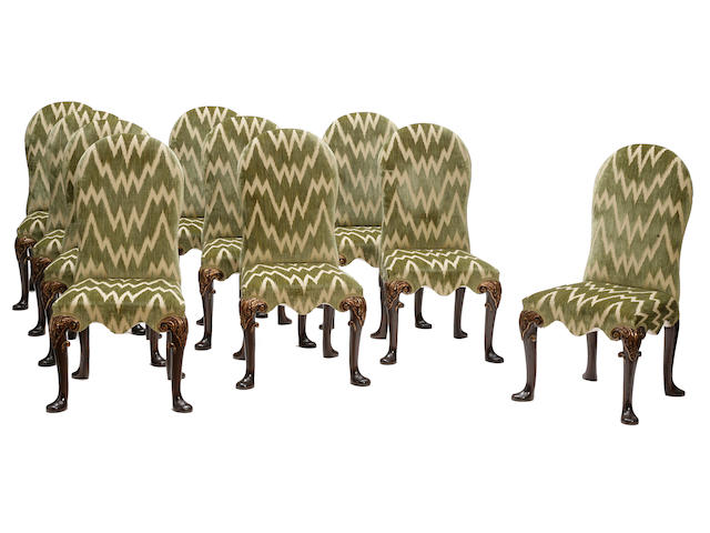A set of ten George II style parcel gilt mahogany stained dining chairs