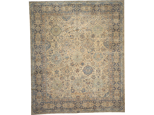 A Kerman carpet  size approximately 12ft. 7in. x 15ft. 3in.
