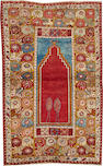 A Turkish rug  size approximately 3ft. 4in. x 5ft. 5in.