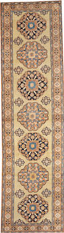 A Northwest Persian runner  size approximately 3ft. 3in. x 11ft. 8in.