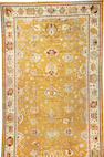 A Contemporary Oushak carpet size approximately 12ft. 1in. x 21ft. 10in.