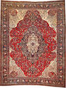 A Sarouk carpet  size approximately 10ft. 6in. x 13ft. 4in.