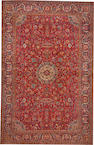 A Kashan rug size approximately 9ft. 10in. x 15ft. 3in.
