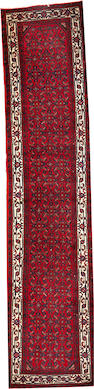 A Hamadan runner  size approximately 2ft. 10in. x 12ft. 7in.