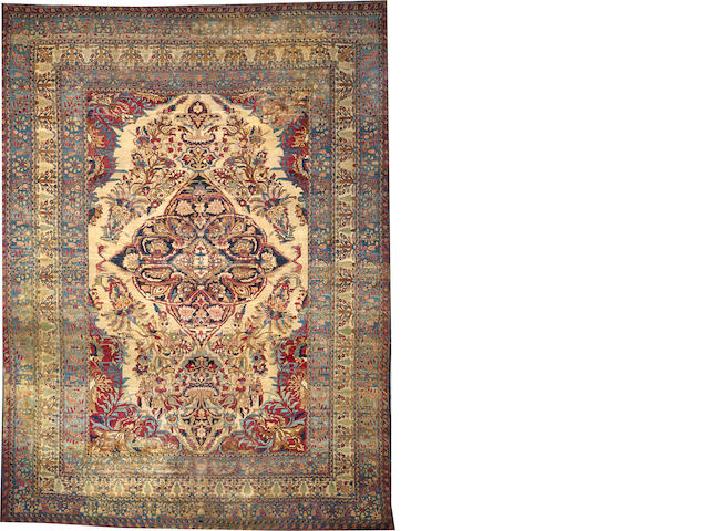 A Lavar Kerman carpet  size approximately 14ft. 6in. x 20ft.