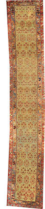A Kurdish runner  size approximately 2ft. 10in. x 16ft. 5in.