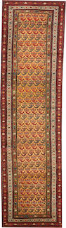 A Northwest Persian runner  size approximately 3ft. 11in. x 14ft. 3in.