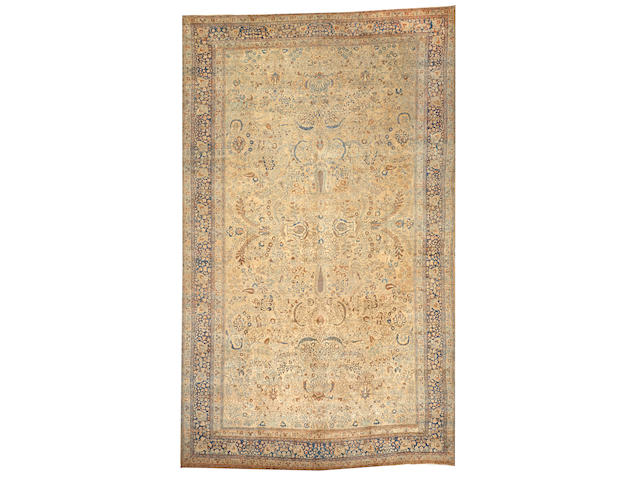 A Tabriz carpet  size approximately 12ft. 8in. x 20ft. 8in.
