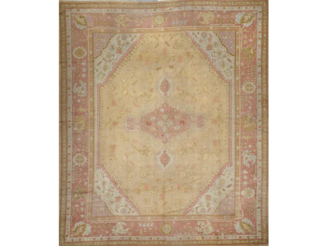 An Oushak carpet  size approximately 13ft. 5in. x 15ft. 8in.