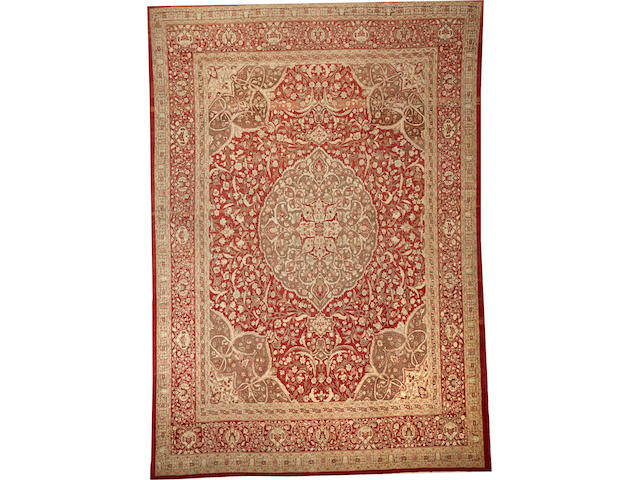 A Tabriz carpet  size approximately 10ft. 10in. x 15ft. 8in.